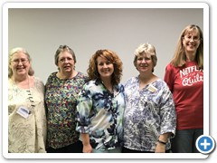 Members with designed Christine Stainbrook at guild meeting
